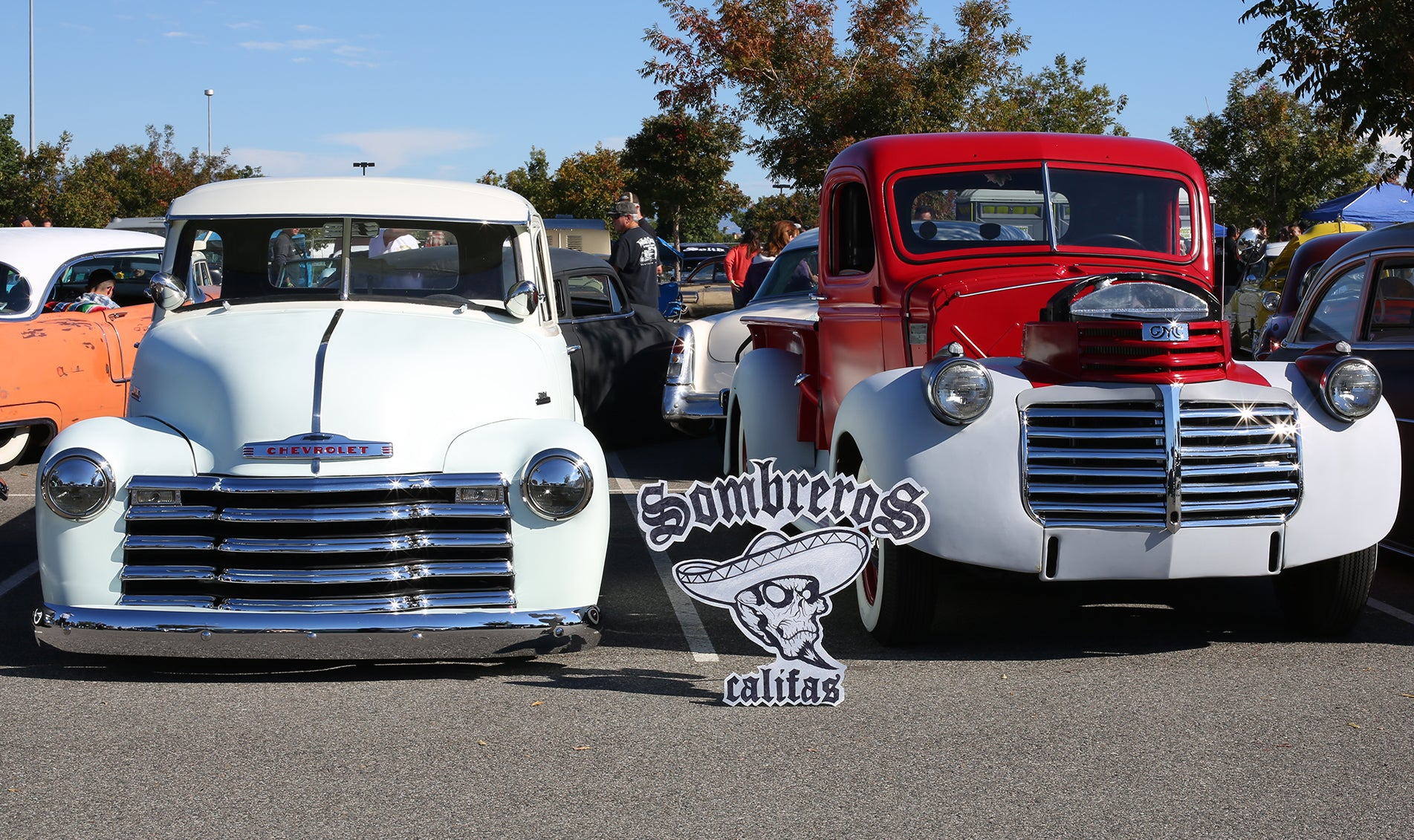 GMC and Chevy truck side by side at Huffarama 2015