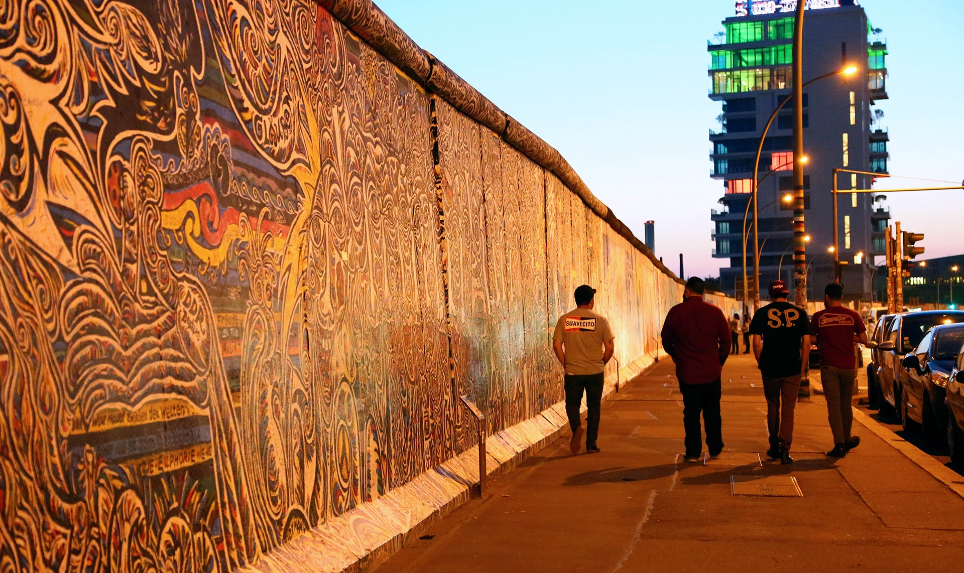 Suavecito Pomade Walking by The Berlin Wall