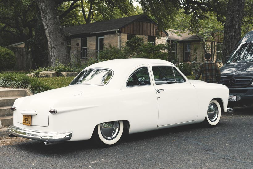 Classic-car-in-white-color-parked-in-the-street-shoebox-car