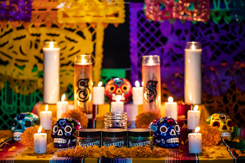 Suavecito Fall Pomade on a table of Dia De Los Muertos deorations.