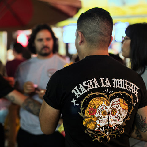 Man wearing our Hasta La Muerte tee at the fair.