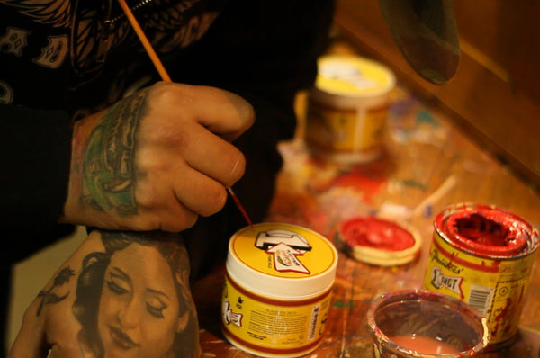 Mr. Rhythm Autographing Limited Edition Cans Of Suavecito Pomade