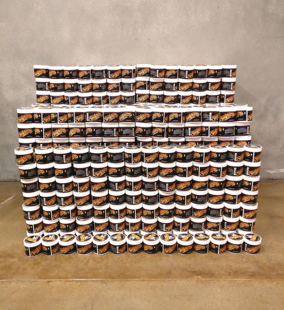 Stack of Men's Grooming Suavecito Hair Pomade Cans
