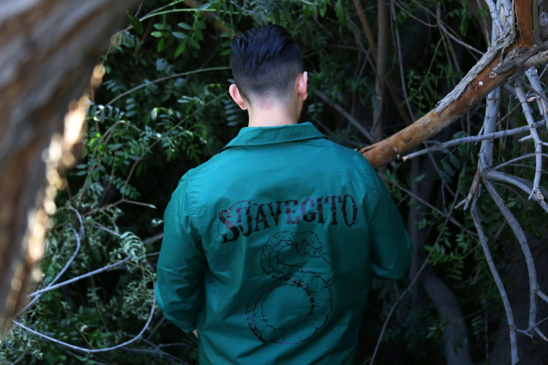 Suavecito Green Windbreaker with a Snake Graphic on the back