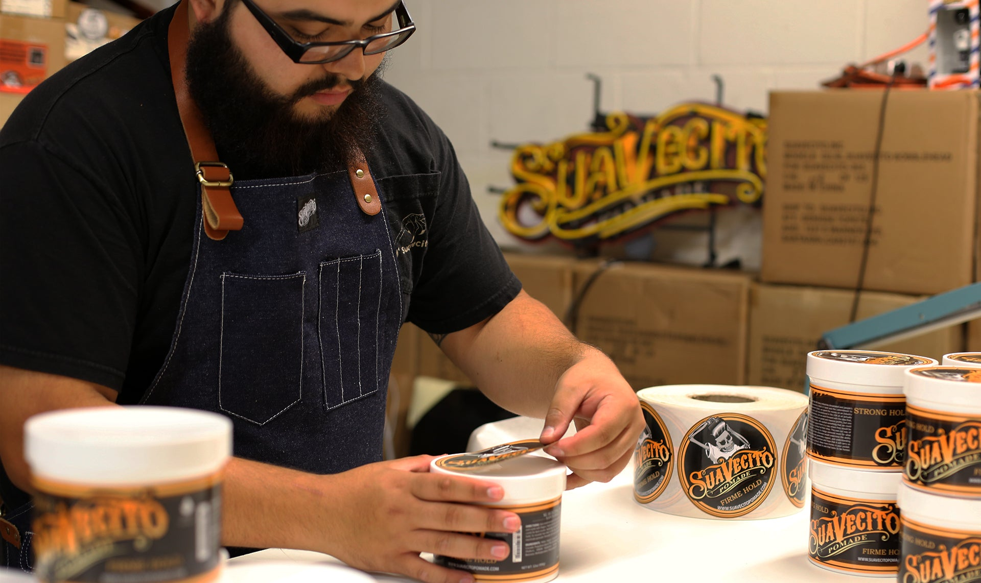 Worker Wearing Suavecito Work Apron in Denim