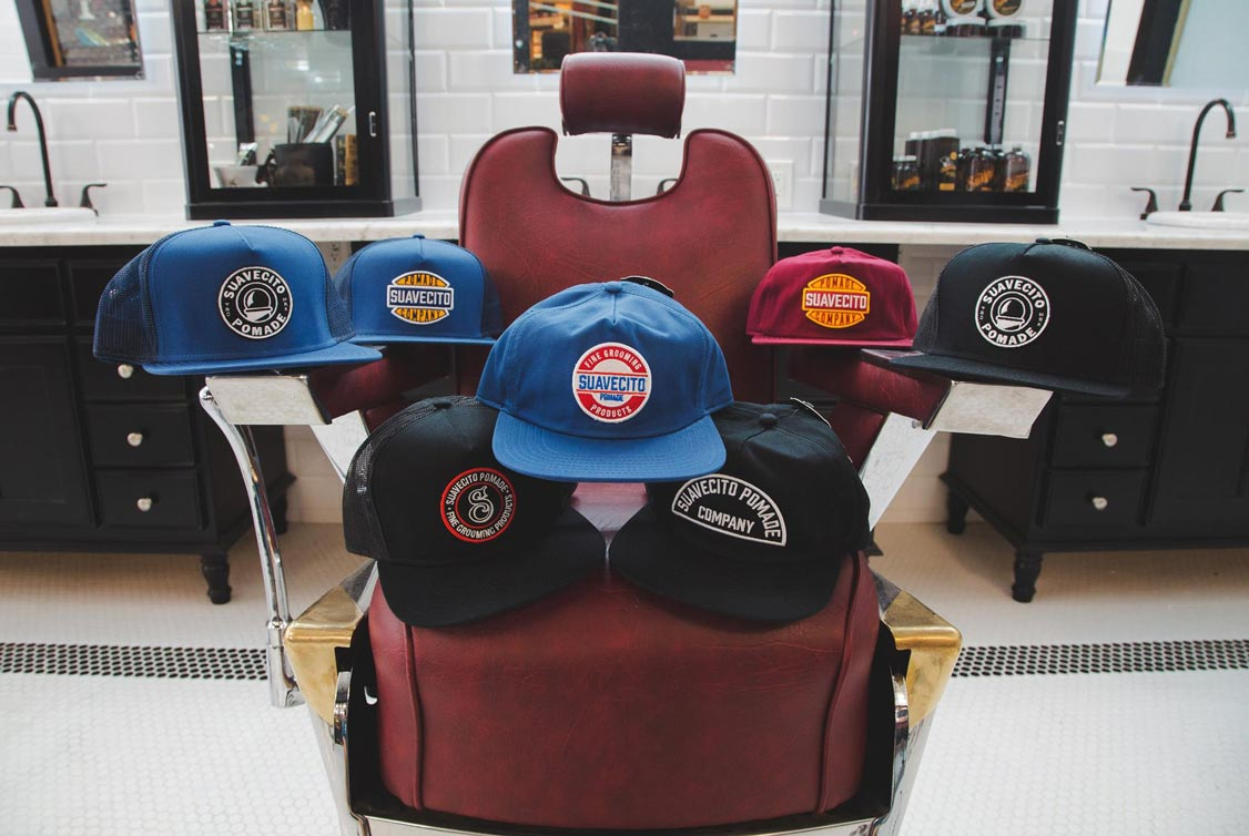 all-the-suavecito-hats-on-a-barber-chair