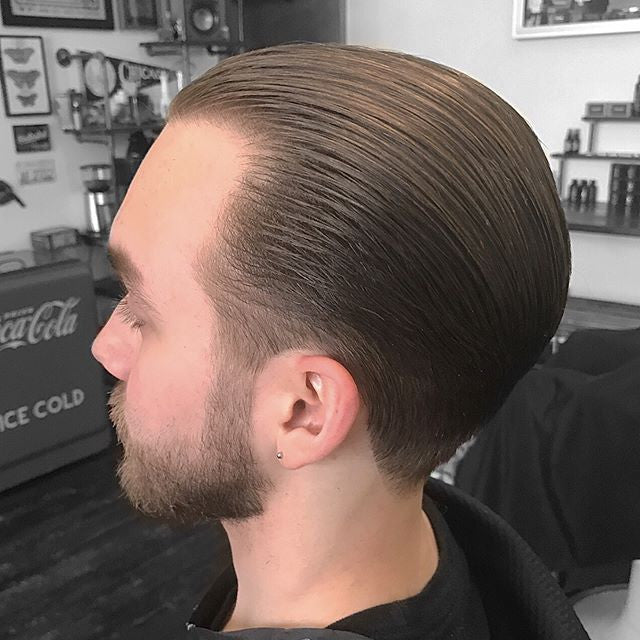 Slickback hairstyle with suavecito pomade barbershop cut