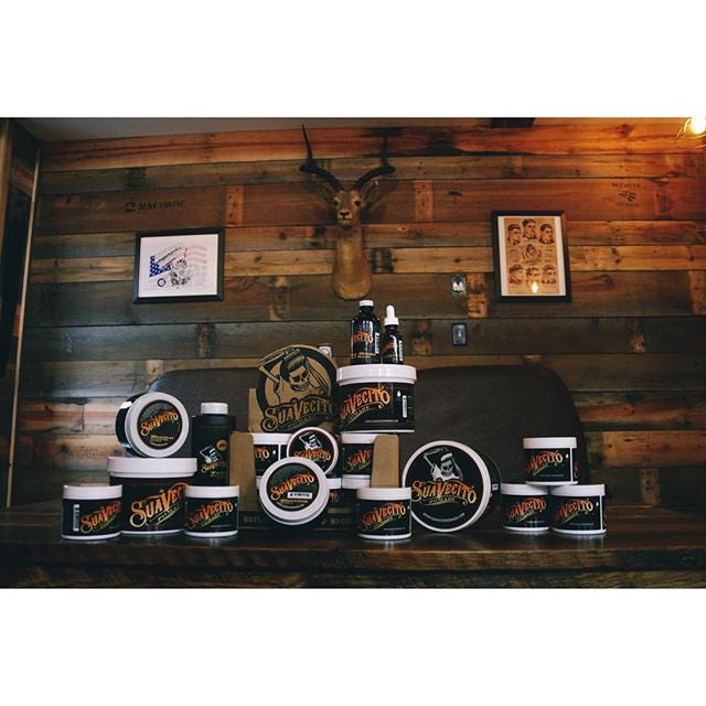 blackdoorbarberco instagram picture of suavecito pomade array of products