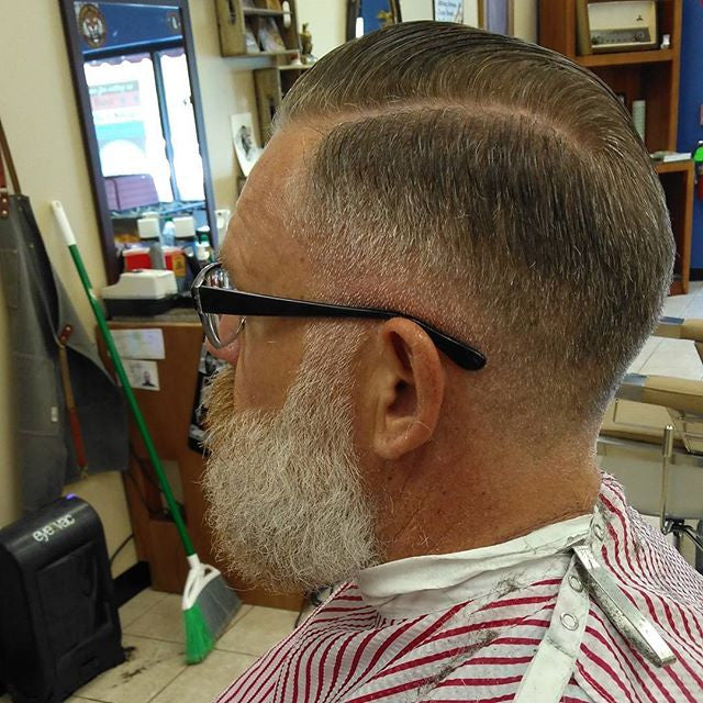bradythebarber_603 sidepart haircut styled with suavecito pomade