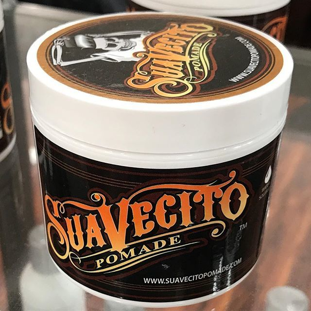 closeup shot of suavecito pomade can firme hold style