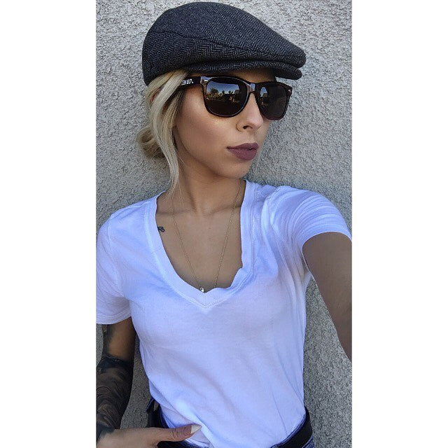 Dee-thatgirl instagram page wearing suavecito sunglasses
