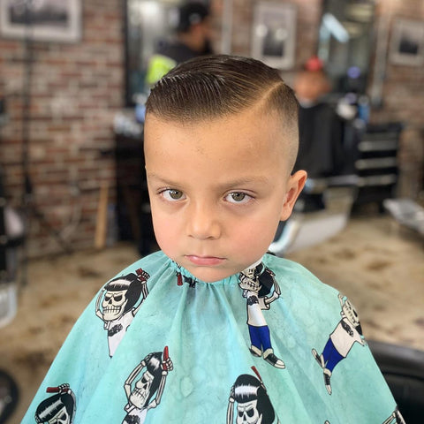 Kid with Suavecito Mascot Barber Cape
