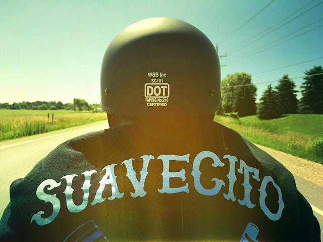 greasyglove motorcycle picture of suavecito jacket on the open road
