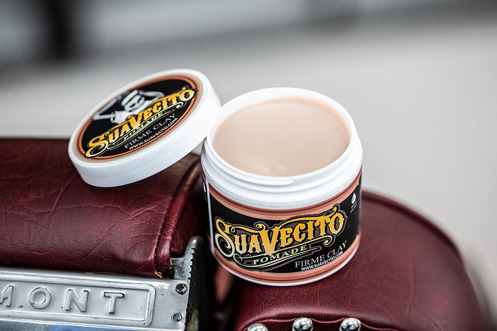 Suavecito Firme Clay Pomade For Hair, open showing the salmon colored clay