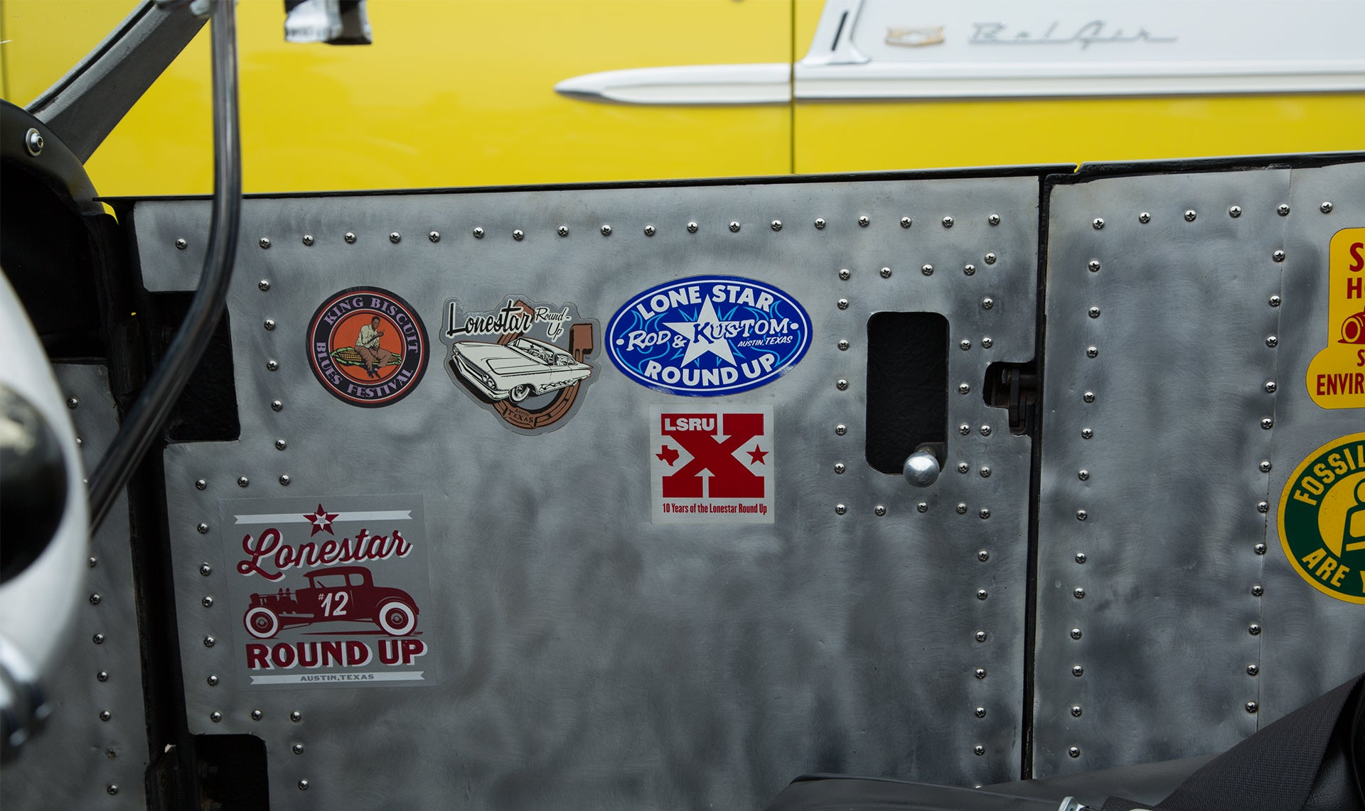 Inside of coupe door with previous Lonestar Roundup stickers