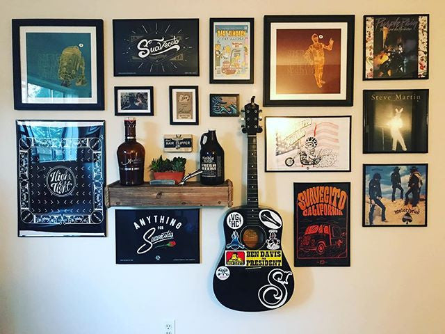 look_itsaj - new office suavecito pomade posters on the wall