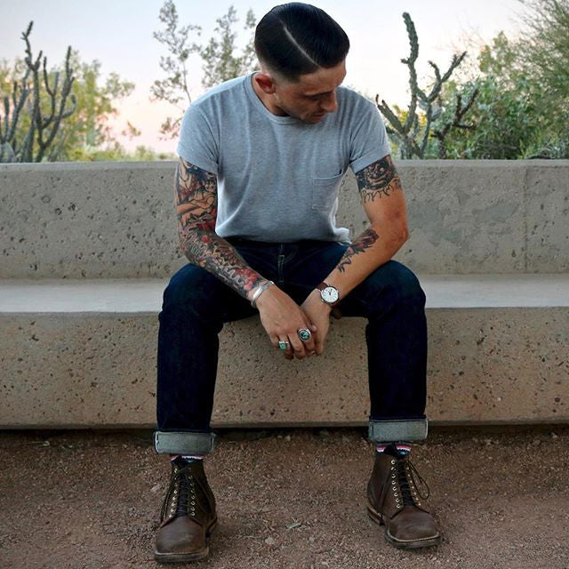 Suavecito hair products used on greaser man with tattoos