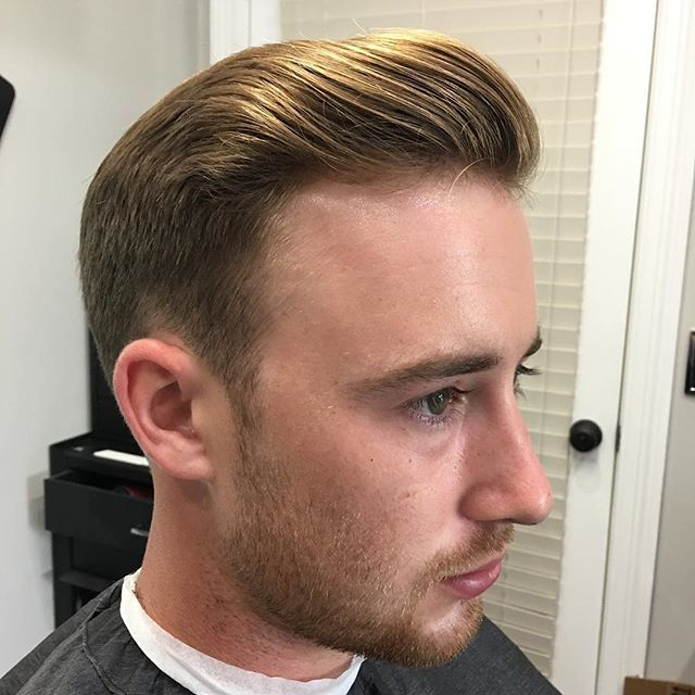 slicked back hairstyle with blonde hair suavecito pomade in hair