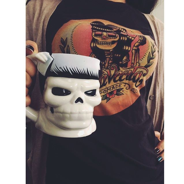 suavecito coffee mug held in hand by a pretty lady