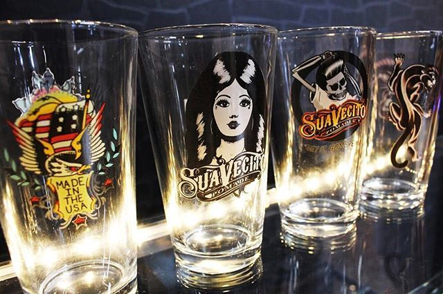 suavecito pomade pint glasses lined up with artwork showing