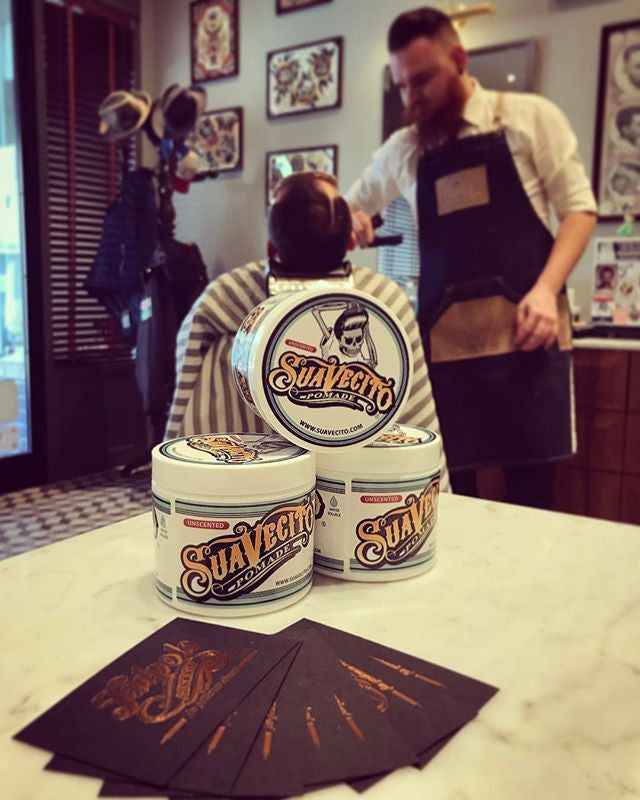 display of suavecito unscented pomade great for blonde hair