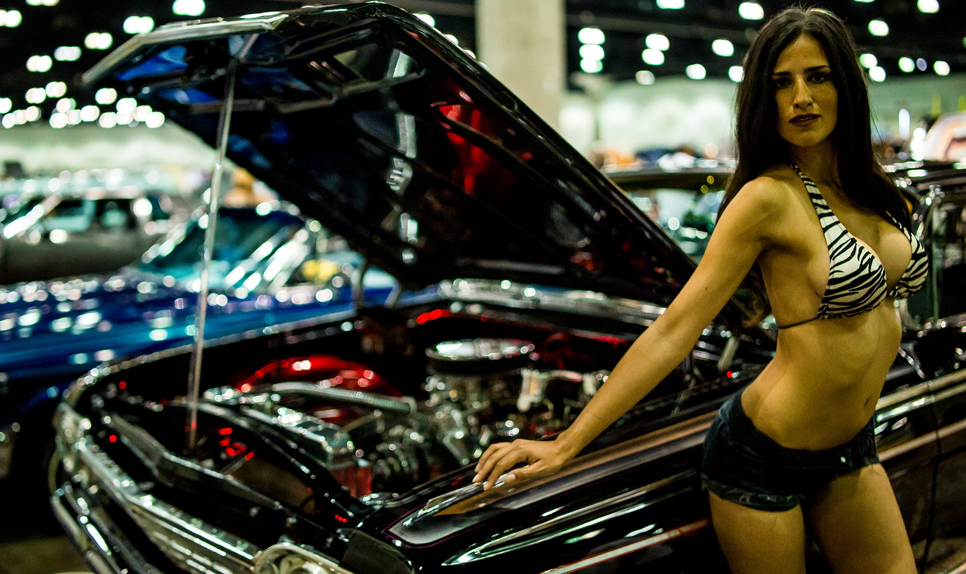 lovely model posing next to lowrider