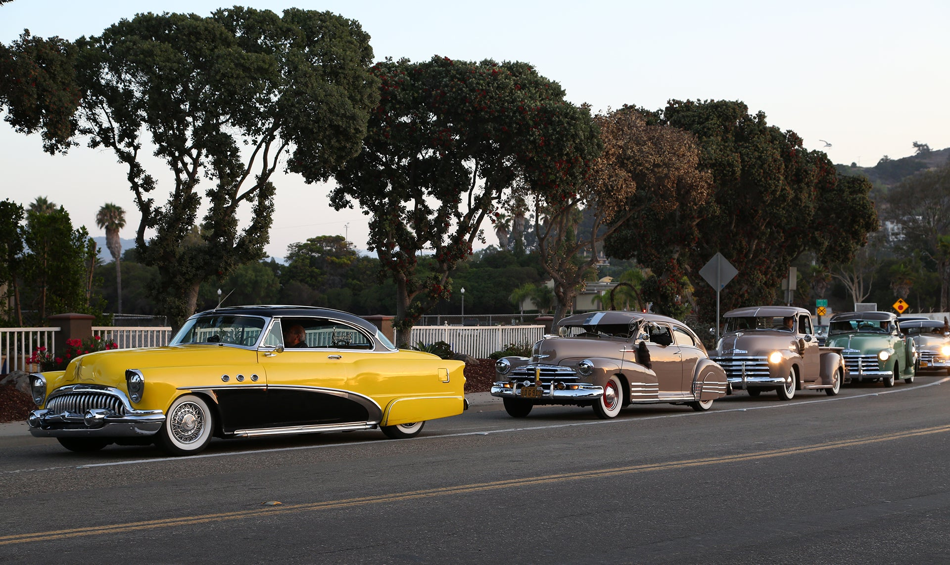 Yellow Buick leads the line as cars enter Ventura Nationals Carshow