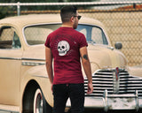 Broken Skull Tee Burgundy - Model is wearing a size medium tee.