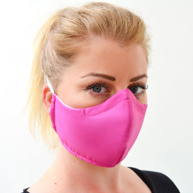 woman wearing a 3 layer reusable bubblegum pink face mask sasmask by screen and shield