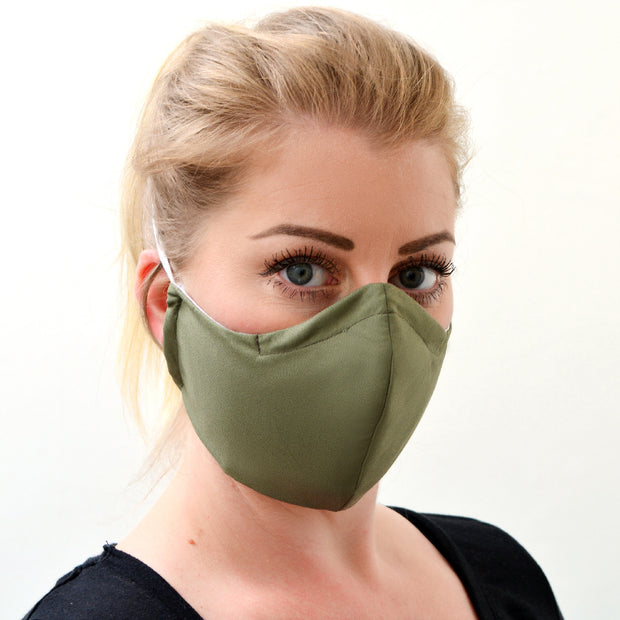woman wearing a 3 layer reusable sage green face mask sasmask by screen and shield
