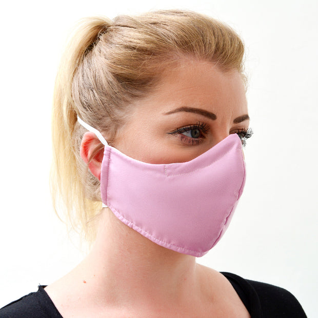 woman wearing a 3 layer reusable pink lemonade face mask sasmask by screen and shield
