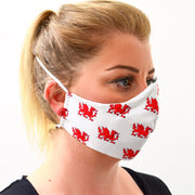 woman wearing a 3 layer reusable Welsh flag face mask sasmask by screen and shield