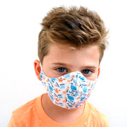 young boy wearing a 3 layer reusable child's face mask with animal pattern sasmask by screen and shield