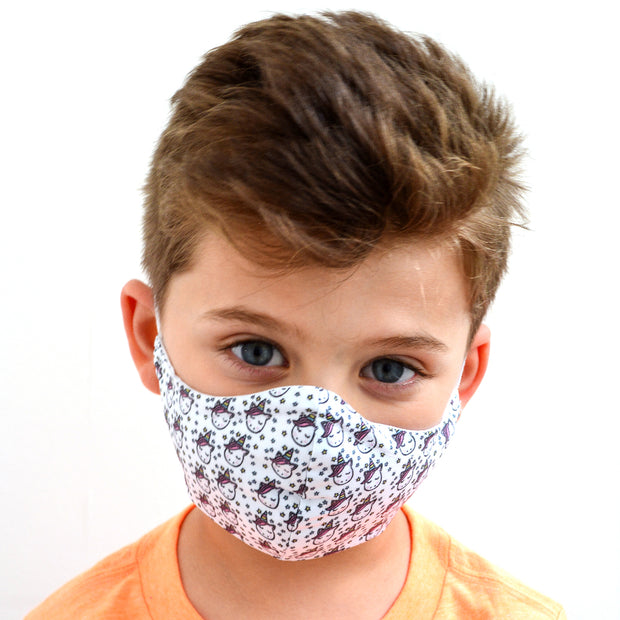 young boy wearing a 3 layer reusable child's face mask with unicorn pattern sasmask by screen and shield