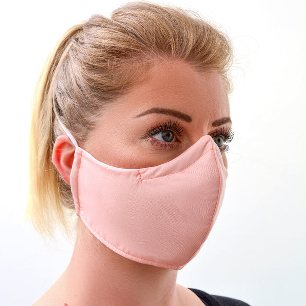 woman wearing a 3 layer reusable light pink sepia face mask sasmask by screen and shield
