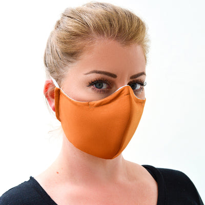 woman wearing a 3 layer reusable orange sandstone face mask sasmask by screen and shield