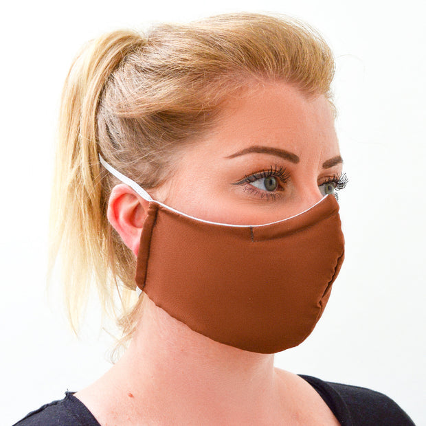 woman wearing a 3 layer reusable brown cinnamon face mask sasmask by screen and shield