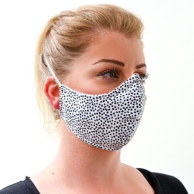 woman wearing a 3 layer reusable face mask with black dots on white pattern sasmask by screen and shield