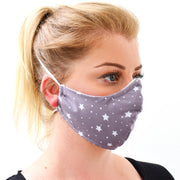 Woman wearing a 3 layer reusable face mask with a light purple grey and white stars pattern sasmask by screen and shield