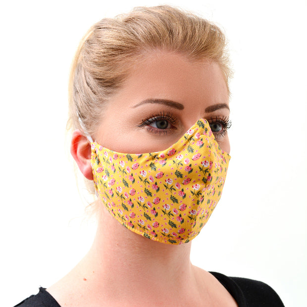 woman wearing a 3 layer reusable face mask with yellow pink ditsy floral pattern sasmask by screen and shield