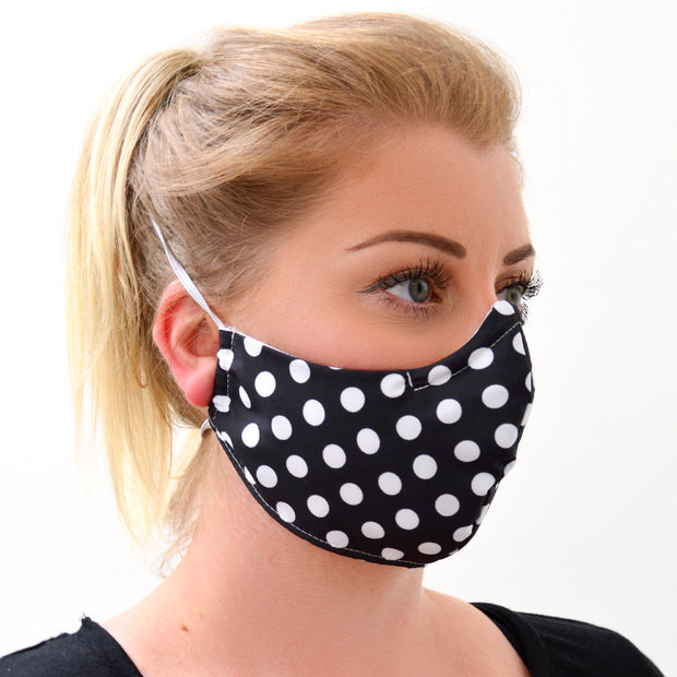 woman wearing a 3 layer reusable face mask with black white polka dot pattern sasmask by screen and shield