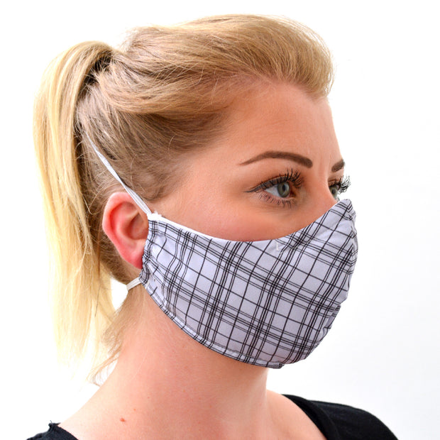 woman wearing a 3 layer reusable face mask with grey tartan pattern sasmask by screen and shield