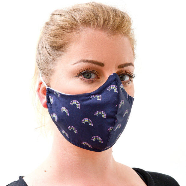 woman wearing a 3 layer reusable face mask with rainbow indigo pattern sasmask by screen and shield