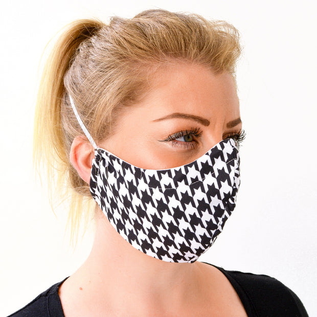 woman wearing a 3 layer reusable face mask with black white houndstooth pattern sasmask by screen and shield
