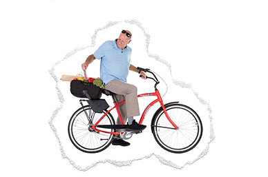 Granddad riding bicycle with bike seat adaptor and tote accessory