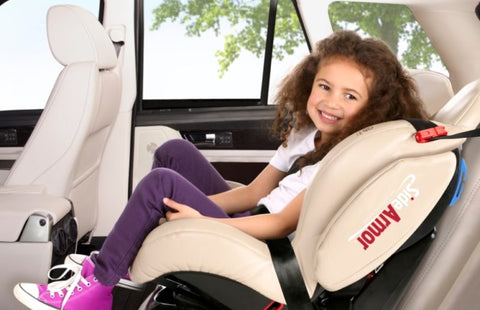 Child sitting in evolution car seat