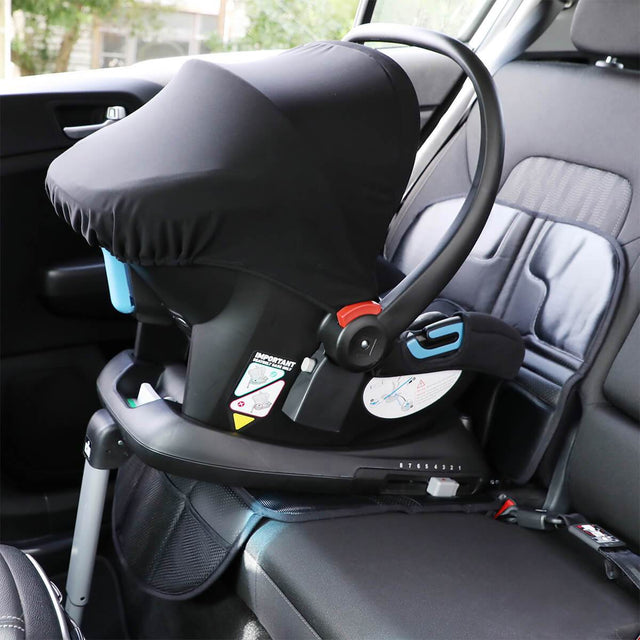 phil&teds® vehicle seat mate™ shown in car under alpha™ car seat and base, protecting the car interior fabrics from spills and indentations_black