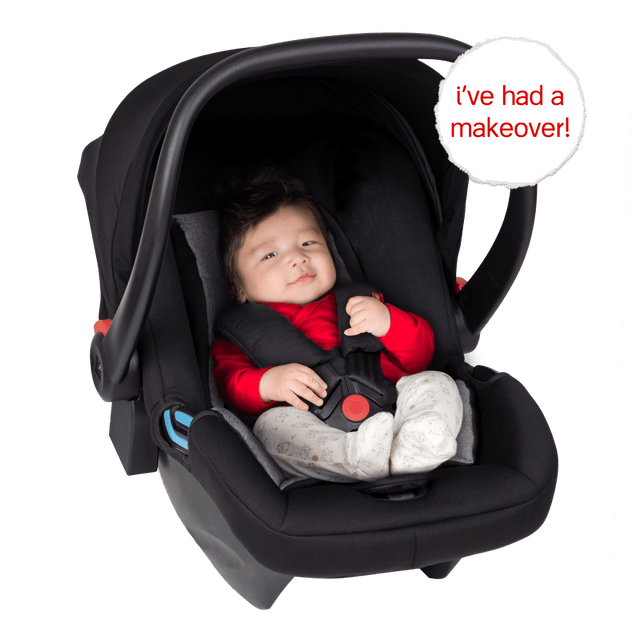 phil&teds alpha™ infant car seat shown with a cute baby safely harnessed into the capsule_black/grey marl