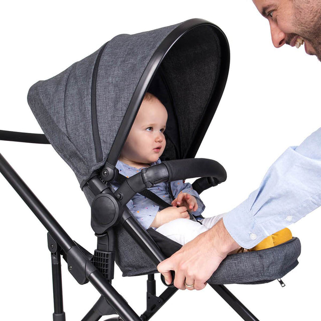 phil&teds voyager in charcoal grey with baby staying confortable with footrest 3 qtr view_charcoal