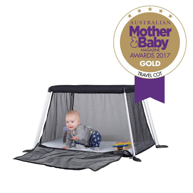 phil&teds award winning traveller travel cot with baby playing inside_black